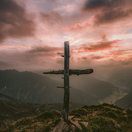 grey wooden cross on mountain